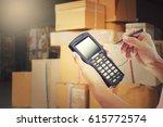 worker scanning package in...   Shutterstock . vector #615772574