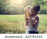 group of diverse kids blowing... | Shutterstock . vector #615781610