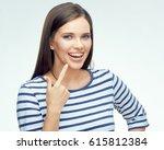 smiling girl pointing finger on ... | Shutterstock . vector #615812384
