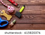 Stock photo concept pet care and training on wooden background top view 615820376