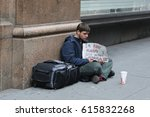 Small photo of NEW YORK - APRIL 4, 2017: Homeless man in front of Macy's store in Midtown Manhattan