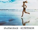 active sporty woman run along... | Shutterstock . vector #615850634