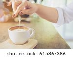 closeup of lady pouring sugar... | Shutterstock . vector #615867386