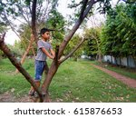 cute boy riding on a tree. | Shutterstock . vector #615876653