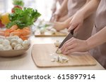 woman cutting mushrooms at... | Shutterstock . vector #615897914