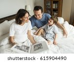 family looking and sharing... | Shutterstock . vector #615904490