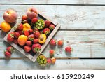summer fruits and berries on a...   Shutterstock . vector #615920249