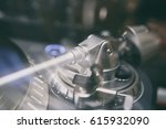 turntables tone arm in focus... | Shutterstock . vector #615932090