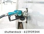 oil dispenser fuel the car at... | Shutterstock . vector #615939344
