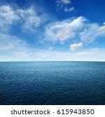 blue sea water surface on sky | Shutterstock . vector #615943850