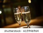 two glasses of champagne ... | Shutterstock . vector #615946964