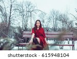 delicate girl in a red winter... | Shutterstock . vector #615948104