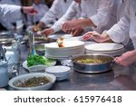 busy team chefs in commercial ... | Shutterstock . vector #615976418