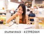 woman enjoy soft drink and... | Shutterstock . vector #615982664
