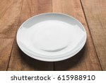empty white plate on wooden... | Shutterstock . vector #615988910