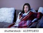 woman watching horror film at... | Shutterstock . vector #615991853