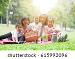 happy asian family portrait at... | Shutterstock . vector #615992096