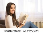 woman with a book   indoor... | Shutterstock . vector #615992924