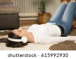 relaxing woman and listening... | Shutterstock . vector #615992930