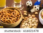 salty snacks and drinks on the... | Shutterstock . vector #616021478