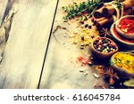 colorful mix of various spices... | Shutterstock . vector #616045784