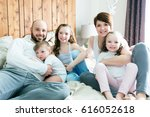 a young happy family of five on ... | Shutterstock . vector #616052618