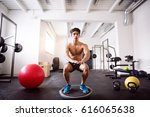 young fit hispanic man in gym... | Shutterstock . vector #616065638