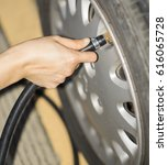 Small photo of Fill air into the tire / to inflate a tire