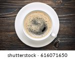 coffee cup on the wooden table. | Shutterstock . vector #616071650