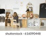 little girl sitting at her desk ... | Shutterstock . vector #616090448