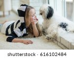 little girl at home with dog | Shutterstock . vector #616102484