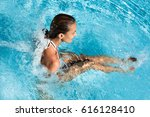 Woman In A Swimming Pool Under...