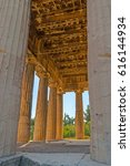 Small photo of Hephaestus Temple boasts well preserved Doric columns, surrounding it, Athens, Greece