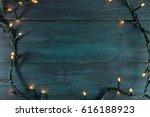 Fairy Lights On A Dark Wooden...