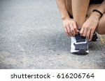 female tying shoe laces for... | Shutterstock . vector #616206764