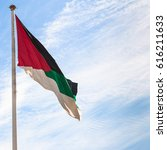 Small photo of Travel to Middle East country Kingdom of Jordan - Flag of the Arab Revolt in Aqaba city with blue sky with white clouds in background