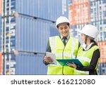 asian businessman and asian... | Shutterstock . vector #616212080