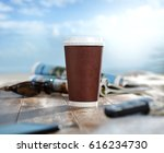 coffee cup on beach  | Shutterstock . vector #616234730