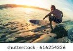 young man surfs the ocean wave... | Shutterstock . vector #616254326