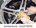male hand with foam sponge... | Shutterstock . vector #616278050