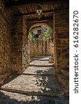 Small photo of Close-up of stone staircase and arch in an alleyway, at the gorgeous medieval hamlet of Les Arcs-sur-Argens. Located in the Provence region, Var department, southeastern France. Retouched photo