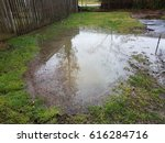 large puddle in lawn | Shutterstock . vector #616284716