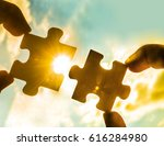 two hands trying to connect... | Shutterstock . vector #616284980