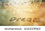 """Word """"dream"""" On A Sand With..."""