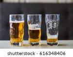Three Glasses Of Light Beer On...