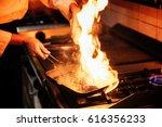 chef in restaurant kitchen...   Shutterstock . vector #616356233