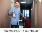 man cleaning hotel hall wearing ... | Shutterstock . vector #616378160