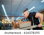 focused man doing dips in the... | Shutterstock . vector #616378193
