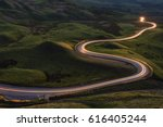 winding curvy rural road with... | Shutterstock . vector #616405244