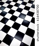 checkered black and white... | Shutterstock . vector #616438700